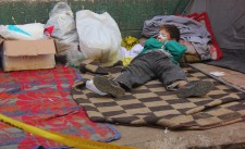 A kid lays down after inhaling tear gas at a makeshift hospital in Cairo February 2012