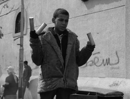 Kid showing canisters canisters during clashes with security forces in Cairo February 2012